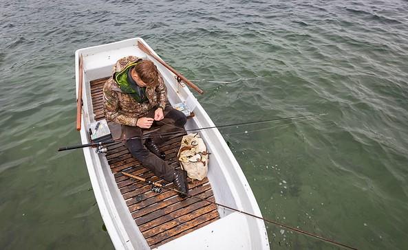 Angler in einem Boot auf dem Schermützelsee, Foto: Florian Läufer