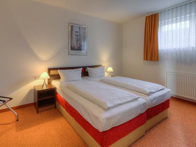 Appartement am See - Schlafzimmer